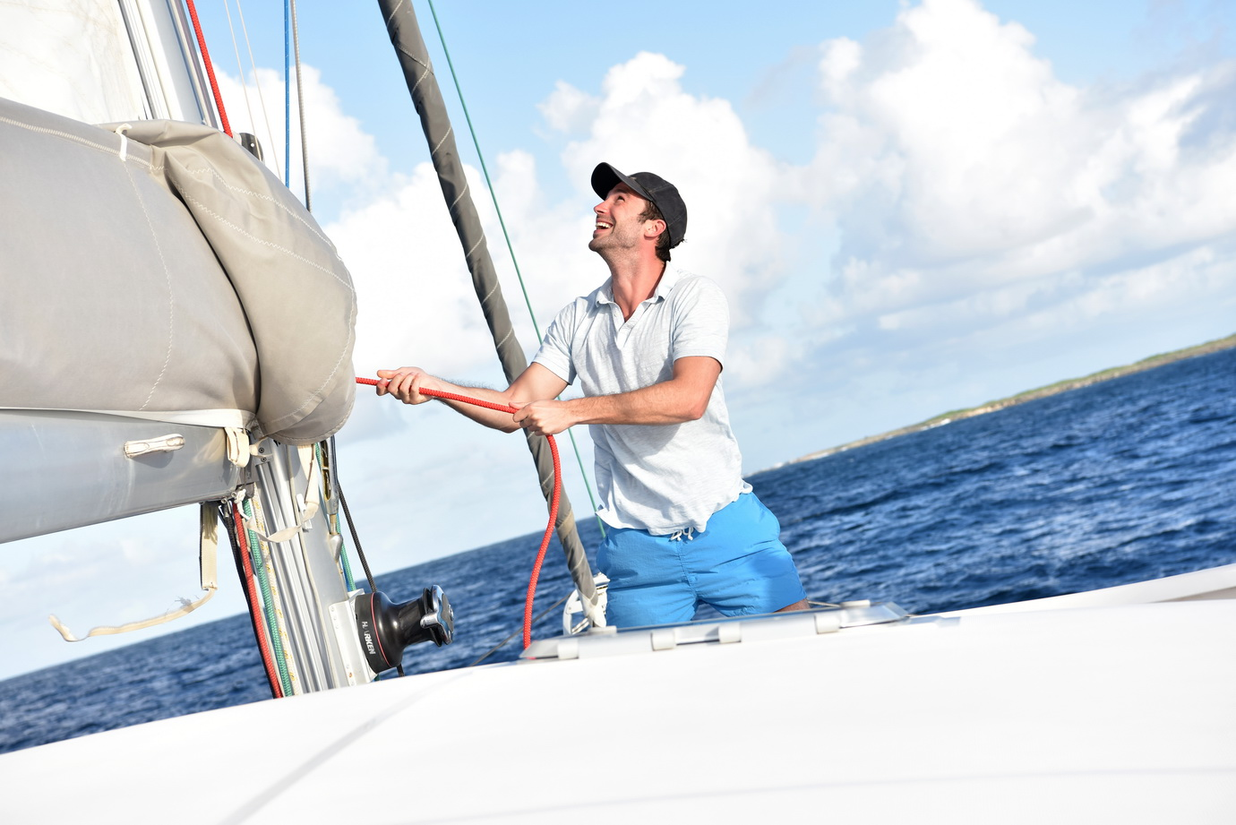 Man pulling on rope to sail out