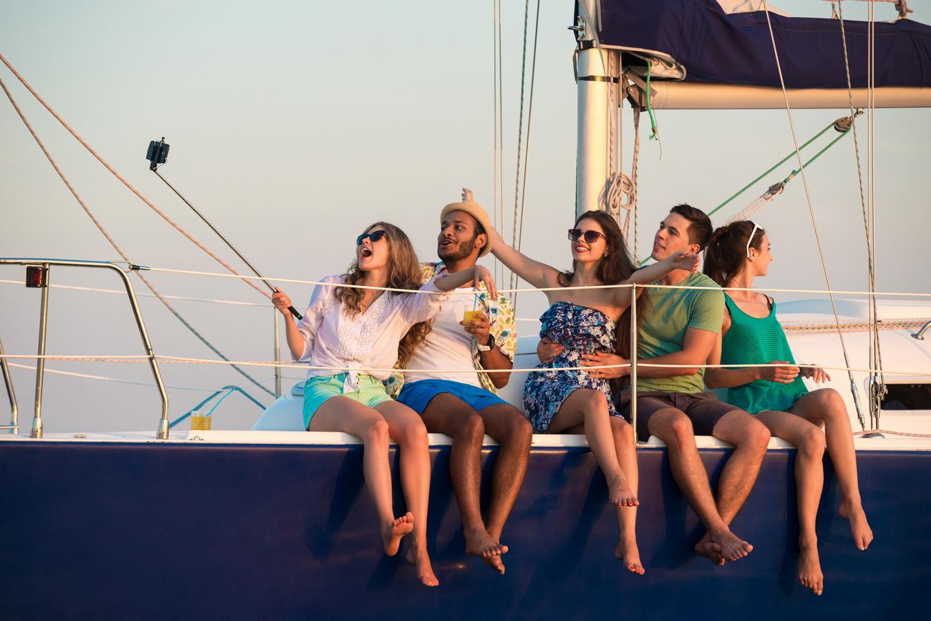 Merry company celebrates birthday on a yacht.